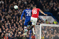 Football - 2019 / 2020 EFL Carabao (League) Cup - Fourth Round: Chelsea vs. Manchester United<br /> <br /> Callum Hudson-Odoi (Chelsea FC) and Marcos Rojo (Manchester United) compete for the header at Stamford Bridge <br /> <br /> COLORSPORT/DANIEL BEARHAM