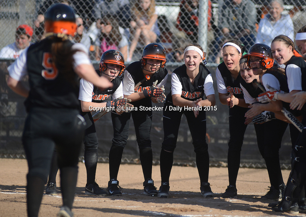 Laura Stoecker/lstoecker@dailyherald.com<br /> St. Charles East's Alex Latoria, left, approaches home plate to be congratulated by teammates after hitting a home run in the first inning vs. Kaneland Wednesday.