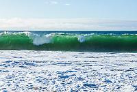 A transluscent breaking wave on Baker Beach, San Fransisco, California, USA.