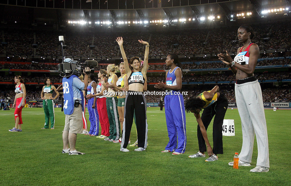 New Zealands Angela McKee is introduced to the huge crowd prior to the Womens High Jump Final in the Athletics at the MCG on day eight of the XV111 Commonwealth Games,Melbourne ,Australia.Thursday March 23,2006.Photo:Joe Mann/PHOTOSPORT. *** Local Caption ***