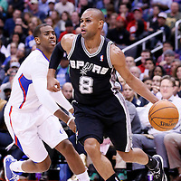 18 February 2014: San Antonio Spurs point guard Patty Mills (8) drives past Los Angeles Clippers point guard Chris Paul (3) during the San Antonio Spurs 113-103 victory over the Los Angeles Clippers at the Staples Center, Los Angeles, California, USA.