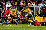 Julian Savea of the Hurricanes passes to Ricky Riccitelli of the Hurricanes in the tackle of Richie Mo'unga of the Crusaders during the Semi Final Super Rugby match, Crusaders V Hurricanes, AMI Stadium, Christchurch, New Zealand, 28th July 2018.Copyright photo: John Davidson / www.photosport.nz
