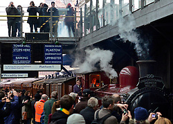 © Licensed to London News Pictures. 13/01/2013. London, UK The train passes the famous listed signage at Earls Court Station. Crowds at Earls Court Underground station as it welcomes the newly restored Met steam Locomotive No. 1 back to the Underground today, 13th January 2013, on the original stretch of the Metropolitan line. This is to mark the 150th anniversary of the opening of the world's first underground in January 1863. The Metropolitan Railway 'Jubilee' Carriage No. 353, recently restored by the Ffestioniog Railway. The Chesham set of Metropolitan Railway Bogie stock coaches (1898-1900), the Metropolitan Railway Milk Van No. 3 (1896) were all pulled by Met No 1 (built 1898) which provided the motive power at the front of the train. Photo credit : Stephen Simpson/LNP