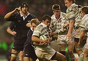 Twickenham, England, RFU Twickenham Stadium, Surrey, 10.12.2002.<br /> 2002 Varsity Rugby - Oxford vs Cambridge<br /> Cambridge No.8 Stewart Eru is held with the ball.    [Mandatory Credit:Peter SPURRIER/Intersport Images]