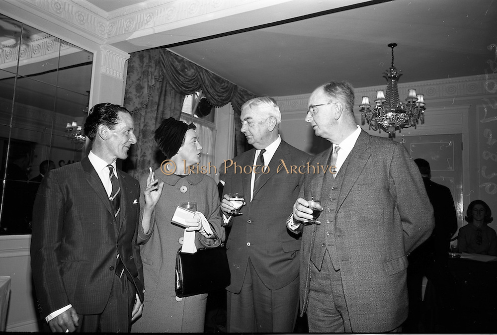 05/05/1965<br /> 05/05/1965<br /> 05 May 1965<br /> Hennessy Press reception at the Gresham Hotel, Dublin to announce the company's plans for sports sponsorship that year. Pictured at the event were (l-r) Mr. Phil Canty, Jockey; Miss Carmel Huban, Leopardstown Club; Mr. Maurice Hennessy, Chairman, Jos. Hennessy and Co. and Mr. Fred Clarke, Managing Director, Lepardstown Club.