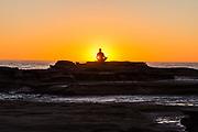 Man in yoga pose at sunrise, Shelly Beach, Caloundra, Sunshine Coast, Queensland, Australia