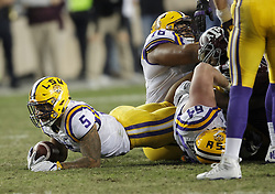 LSU running back Derrius Guice (5) stretches out for more yards against Texas A&M during the second quarter of an NCAA college football game Thursday, Nov. 24, 2016, in College Station, Texas. (Sam Craft/The Eagle)