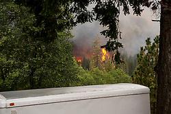 September 12, 2015 - Lake County, California, Smoke and flames entering the western boundry of the Hoberg's Resort.  (Kim Ringeisen / Polaris)