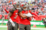 Tampa Bay Buccaneers Linebacker Kevin Minter (51) celebrates an interception with Tampa Bay Buccaneers Defensive Back Jordan Whitehead (31) during the International Series match between Tampa Bay Buccaneers and Carolina Panthers at Tottenham Hotspur Stadium, London, United Kingdom on 13 October 2019.