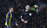 Referee Michael Oliver shows yellow card to Brighton's Inigo Calderon during the The FA Cup match between Brighton and Hove Albion and Arsenal at the American Express Community Stadium, Brighton and Hove, England on 25 January 2015. Photo by Phil Duncan.