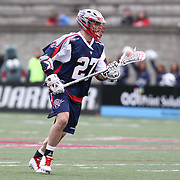 Kevin Buchanan #27 of the Boston Cannons runs with the ball during the game at Harvard Stadium on April 27, 2014 in Boston, Massachusetts. (Photo by Elan Kawesch)