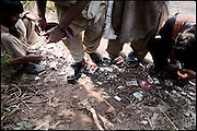 "Four people, all drug abusers, during moments of their consumption of heroin. Islamabad, Pakistan, on friday, August 29 2008.....""Pakistan is one of the countries hardest hits by the narcotics abuse into the world, during the last years it is facing a dramatic crisis as it regards the heroin consumption. The Unodc (United Nations Office on Drugs and Crime) has reported a conspicuous decline in heroin production in Southeast Asia, while damage to a big expansion in Southwest Asia. Pakistan falls under the Golden Crescent, which is one of the two major illicit opium producing centres in Asia, situated in the mountain area at the borderline between Iran, Afghanistan and Pakistan itself. .During the last 20 years drug trafficking is flourishing in the Country. It is the key transit point for Afghan drugs, including heroin, opium, morphine, and hashish, bound for Western countries, the Arab states of the Persian Gulf and Africa..Hashish and heroin seem to be the preferred drugs prevalence among males in the age bracket of 15-45 years, women comprise only 3%. More then 5% of whole country's population (constituted by around 170 milion individuals),  are regular heroin users, this abuse is conspicuous as more of an urban phenomenon. The substance is usually smoked or the smoke is inhaled, while small number of injection cases have begun to emerge in some few areas..Statistics say, drug addicts have six years of education. Heroin has been identified as the drug predominantly responsible for creating unrest in the society."""