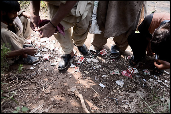 """Four people, all drug abusers, during moments of their consumption of heroin. Islamabad, Pakistan, on friday, August 29 2008.....""""Pakistan is one of the countries hardest hits by the narcotics abuse into the world, during the last years it is facing a dramatic crisis as it regards the heroin consumption. The Unodc (United Nations Office on Drugs and Crime) has reported a conspicuous decline in heroin production in Southeast Asia, while damage to a big expansion in Southwest Asia. Pakistan falls under the Golden Crescent, which is one of the two major illicit opium producing centres in Asia, situated in the mountain area at the borderline between Iran, Afghanistan and Pakistan itself. .During the last 20 years drug trafficking is flourishing in the Country. It is the key transit point for Afghan drugs, including heroin, opium, morphine, and hashish, bound for Western countries, the Arab states of the Persian Gulf and Africa..Hashish and heroin seem to be the preferred drugs prevalence among males in the age bracket of 15-45 years, women comprise only 3%. More then 5% of whole country's population (constituted by around 170 milion individuals),  are regular heroin users, this abuse is conspicuous as more of an urban phenomenon. The substance is usually smoked or the smoke is inhaled, while small number of injection cases have begun to emerge in some few areas..Statistics say, drug addicts have six years of education. Heroin has been identified as the drug predominantly responsible for creating unrest in the society."""""""