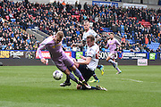 Bolton Wanderers Defender, Rob Holding gives away a penalty during the Sky Bet Championship match between Bolton Wanderers and Reading at the Macron Stadium, Bolton, England on 2 April 2016. Photo by Mark Pollitt.