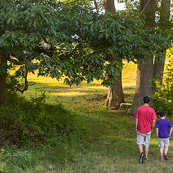 Two boys walk on the Brave Boat Harbor Headwaters preserve in Kittery, Maine.