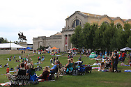 People enjoy picnic and food truck dinners on Art Hill in Forest Park during St. Louis Art Museum's free Outdoor Film Series on Friday nights throughout July; St. Louis, MO