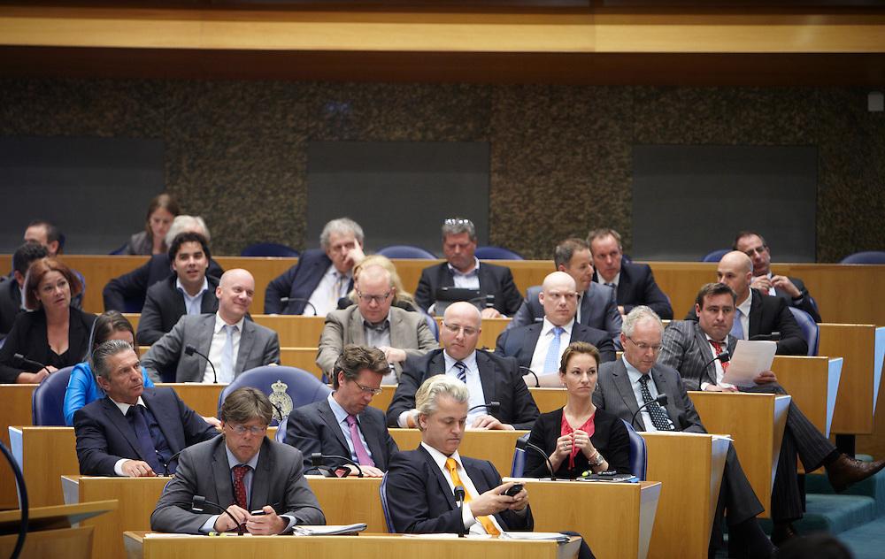Nederland. Den Haag, 24 mei 2012.<br /> PVV fractie, Geert Wilders<br /> Verantwoordingsdebat, nav de derde woensdag in mei, tweede kamer, politiek, parlement, <br /> Foto : Martijn Beekman