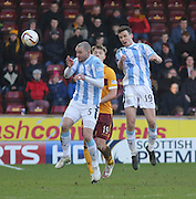 Dundee's Paul McGinn and James McPake clear from Motherwell's Lee Erwin - Motherwell v Dundee, SPFL Premiership at Fir Park<br /> <br />  - &copy; David Young - www.davidyoungphoto.co.uk - email: davidyoungphoto@gmail.com