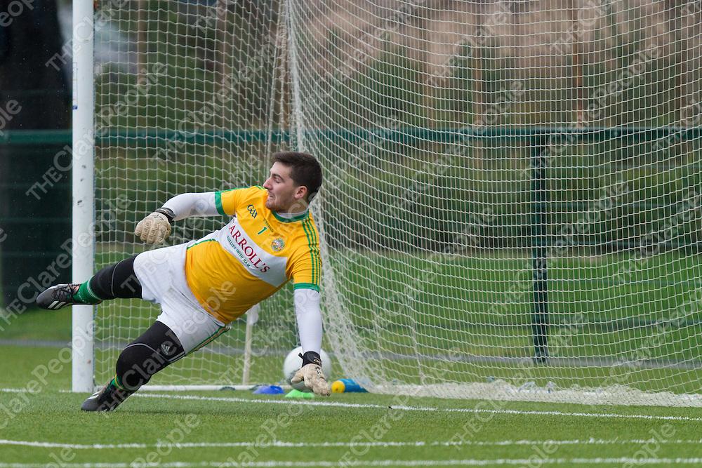 Offaly Goalee Conor Ó Clanasigh conceeds a Clare Goal