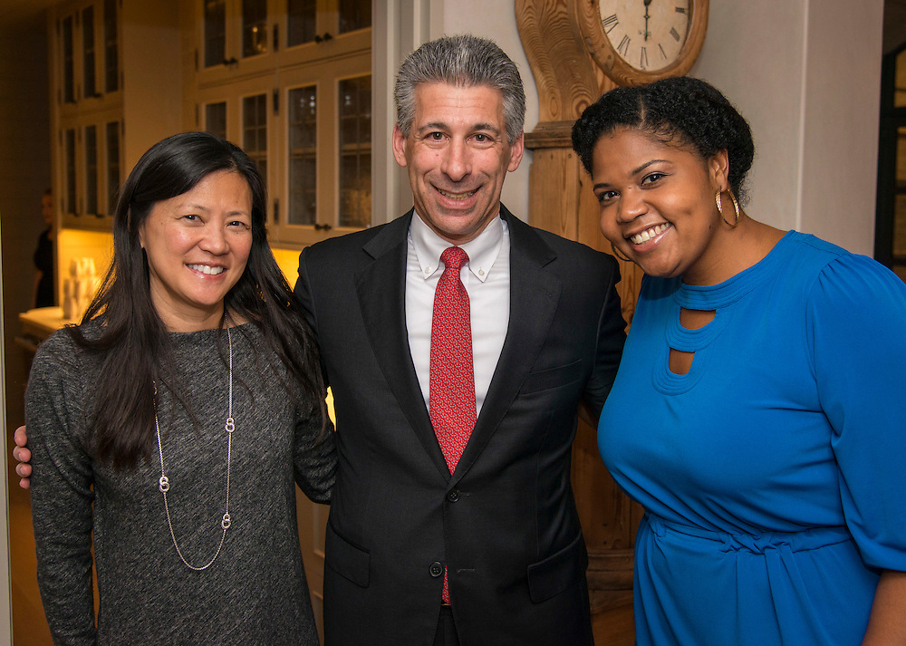 Claire and Joseph Greenberg pose for a photograph with Jasmine Jenkins, right, during a State of the Schools VIP reception at the home of Douglas and Sarah Foshee, January 17, 2017.