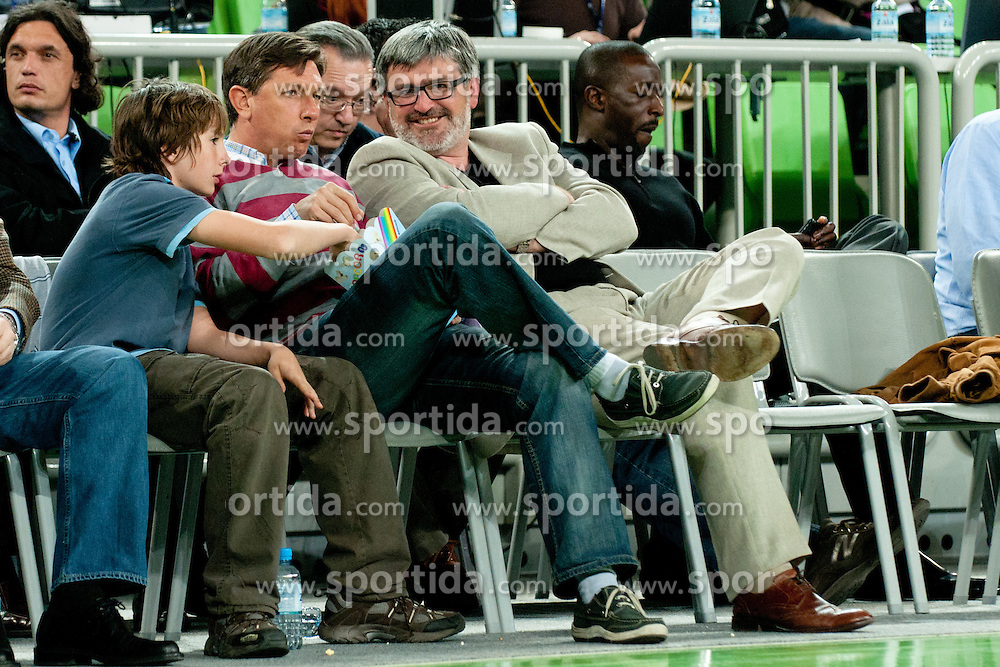 Slovenian Prime Minister Borut Pahor eating popcorn, his son and Roman Jakic, Director of Zavod Tivoli, during first semi-final match of Basketball NLB League at Final four tournament between KK Partizan Belgrade, Serbia and KK Buducnost Podgorica, Montenegro, on April 19, 2011 at SRC Stozice, Ljubljana, Slovenia. (Photo By Matic Klansek Velej / Sportida.com)