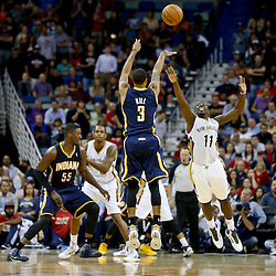 Oct 30, 2013; New Orleans, LA, USA; Indiana Pacers point guard George Hill (3) shoots over New Orleans Pelicans point guard Jrue Holiday (11) during the fourth quarter of a game at New Orleans Arena. The Pacers defeated the Pelicans 95-90. Mandatory Credit: Derick E. Hingle-USA TODAY Sports