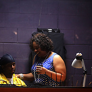 Joy Gregory, right, talks to crew member Cudiman before a performance of Smokey Joe's Cafe Sunday June 15, 2014 at the Scottish Rite Theater in Wilmington, N.C. (Jason A. Frizzelle)