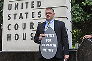 Jonathan Henderson, founder of Vanishing Earth, an environmental watchdog organization at a rally held on the 8 year anniversary of the BP OIl Spill in front of the federal court house in New Orleans calling for justice for the BP OIl Spill clean-up workers who still havent had their day in court.