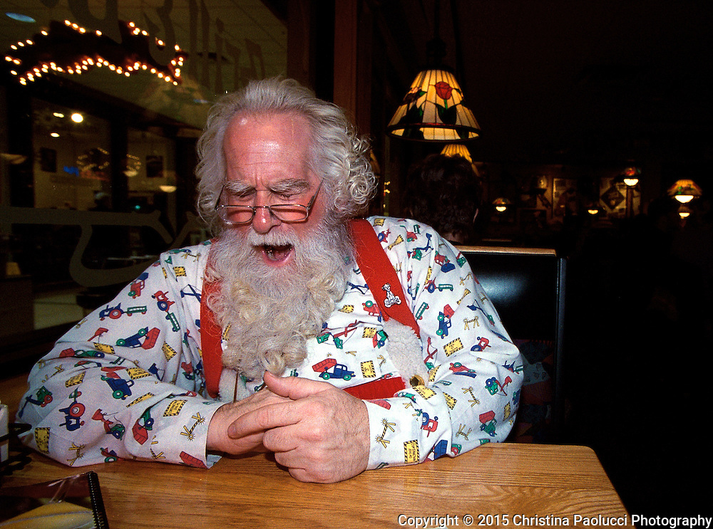 It's been a long day for Santa when he sat down for a dinner break at AppleBees.  Each evening, many people say hello as they walk by or stop and asks for a picture and Santa is always happy too, some can't believe it is really him they see having dinner.   (Rochester Post-Bulletin,Christina Paolucci)