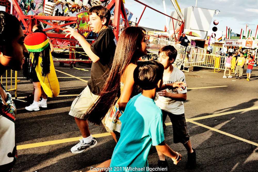 EAST RUTHERFORD, NJ - July 01:  People attend the State Fair at the New Meadowlands Fairgrounds on July 01, 2011 in EAST RUTHERFORD, NJ.  The first Fair at the Meadowlands opened in 1986 as a 6-day event encompassing 10 acres offering a dozen rides and games. Today State Fair Meadowlands at Giants Stadium Fairgrounds is the largest in New Jersey and in the NY Metro area encompassing 35 acres, featuring over 150 rides and attractions plus over 75 food vendors from around the country.  (Photo by Michael Bocchieri/Bocchieri Archive)