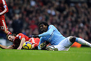 Emmanuel Adebayor (Manchester City) & Sotirios Kyrgiakos (Liverpool) during the Barclays Premier League match between Liverpool and Manchester City at Anfield - 21/11/09