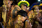Manoki (Irantxe) men and boy playing their traditional flutes.