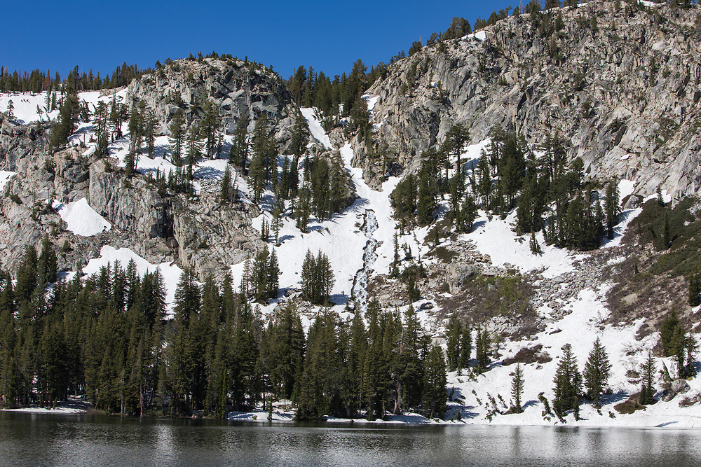 The Eastern Sierra's towns of Mammoth Lakes, June Lakes and surrounding areas weathered a historical and record producing winter snowfall that carried over into the summer. Lakes were filled to capacity and beyond and the waterfall flowing into Lake George was flowing in late June. The lake was still closed to fishing and camping.