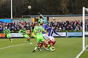 Exeter City goalkeeper Christy Pym(1) punches clear a Forest Green Rovers Reece Brown(10) free kick during the The FA Cup match between Forest Green Rovers and Exeter City at the New Lawn, Forest Green, United Kingdom on 2 December 2017. Photo by Shane Healey.