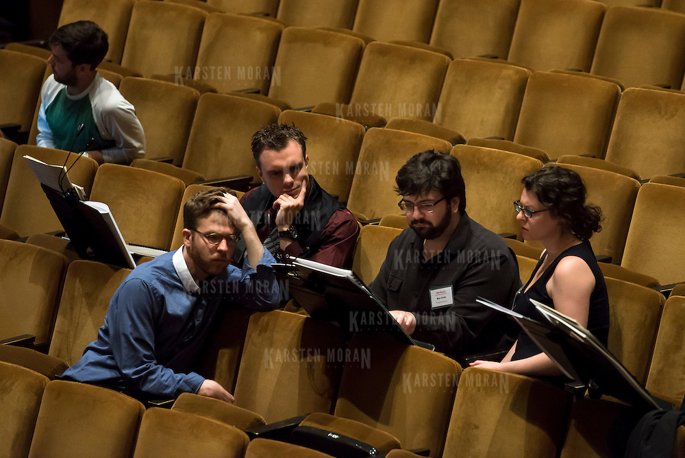 June 3, 2014 - New York, NY : From left, composers William Dougherty, Andrew McManus, Max Grafe, and Julia Adolphe interact during a break in rehearsal with the New York Philharmonic at Avery Fisher Hall on Tuesday. Three works by little-known composers, such as those pictured here, will be selected for inclusion in the New York Philharmonic's Biennial. CREDIT: Karsten Moran for The New York Times