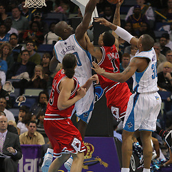 Jan 29, 2010; New Orleans, LA, USA; Chicago Bulls guard Derrick Rose (1) shoots over New Orleans Hornets center Emeka Okafor (50) and forward David West (30) during overtime at the New Orleans Arena. The Bulls defeated the Hornets 108-106 in overtime. Mandatory Credit: Derick E. Hingle-US PRESSWIRE