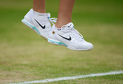 LONDON, ENGLAND - Monday, July 2, 2012: The Nike tennis shoes of Petra Kvitova (CZE) during the Ladies' Singles 4th Round match on day seven of the Wimbledon Lawn Tennis Championships at the All England Lawn Tennis and Croquet Club. (Pic by David Rawcliffe/Propaganda)