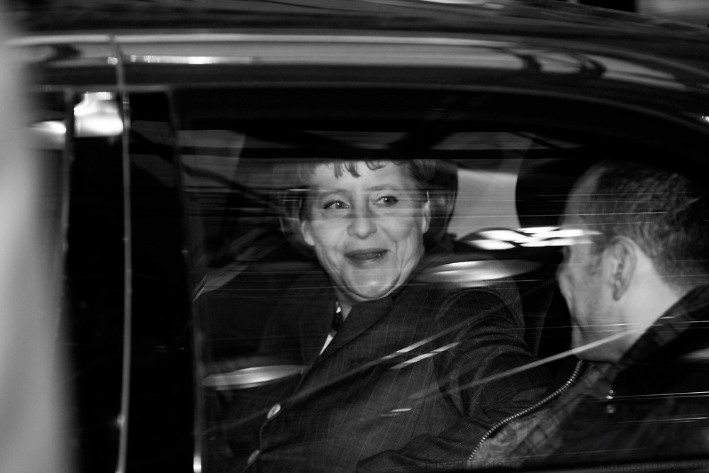 BRUSSELS - BELGIUM - 12 DECEMBER 2008 -- EU Summit under the French Presidency -- A smiling Angela MERKEL,  Federal Chancellor of Germany, leaving the summit. Next to her in the car a unknown civil servant. Photo: Erik Luntang