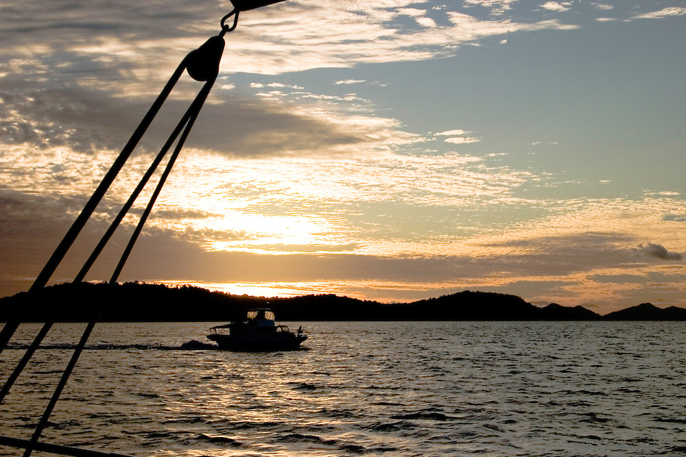Australia, Queensland, Great Barrier Reef. Sailing, boats, sunset