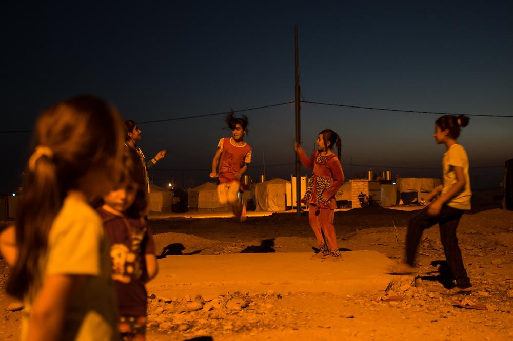 Children playing in the Yazidi IDP Camp near Dohuk in Khanke, Iraq, July 16, 2016