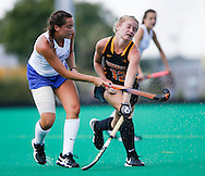 Iowa's Taylor Omweg (right) is struck in the arm by Carly Kissinger of St. Louis as Kissinger passes the ball to a teammate at a college field hockey game between the University of Iowa and St. Louis University at Grant Field in Iowa City on Sunday, Sept. 4, 2016. Iowa won the game 11-0 and improved their standings for the season to 3-1. (Rebecca F. Miller/The Gazette)