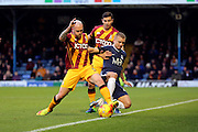 Southend United defender Jason Demetriou (24) battles for possession with Bradford City midfielder Nicky Law (4)  during the EFL Sky Bet League 1 match between Southend United and Bradford City at Roots Hall, Southend, England on 19 November 2016. Photo by Matthew Redman.