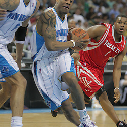 16 March 2009: New Orleans Hornets guard Antonio Daniels (50) drives past Houston Rockets guard Kyle Lowry (7) during a NBA game between the New Orleans Hornets and the Houston Rockets at the New Orleans Arena in New Orleans, Louisiana.