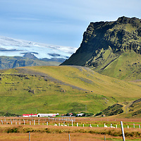 Meadows, farm, mountains & Myrdalsjokull glacier