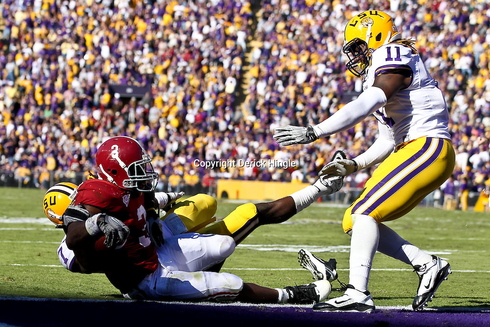 November 6, 2010; Baton Rouge, LA, USA;  LSU Tigers cornerback Patrick Peterson (7) attempts to tackle Alabama Crimson Tide running back Trent Richardson (3) as he crosses goal line for a touchdown during the first half at Tiger Stadium.  Mandatory Credit: Derick E. Hingle