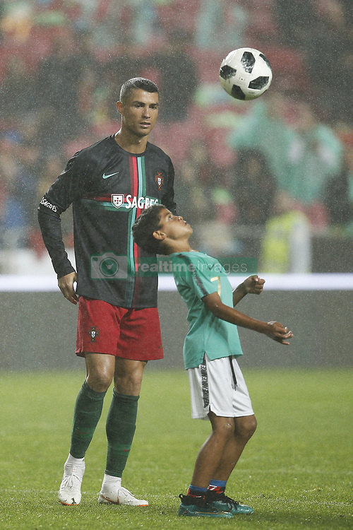 June 7, 2018 - Lisbon, Portugal - Portugal's forward Cristiano Ronaldo's son Cristianinho plays with is father at the end of during the FIFA World Cup Russia 2018 preparation match between Portugal vs Algeria in Lisbon on June 7, 2018. (Credit Image: © Carlos Palma/NurPhoto via ZUMA Press)