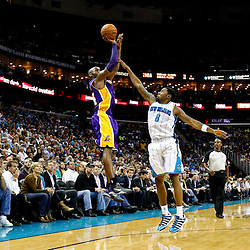 Dec 5, 2012; New Orleans, LA, USA; Los Angeles Lakers shooting guard Kobe Bryant (24) shoots over New Orleans Hornets shooting guard Roger Mason Jr. (8) during the second quarter of a game at the New Orleans Arena.  The Lakers defeated the Hornets 103-87. Mandatory Credit: Derick E. Hingle-USA TODAY Sports