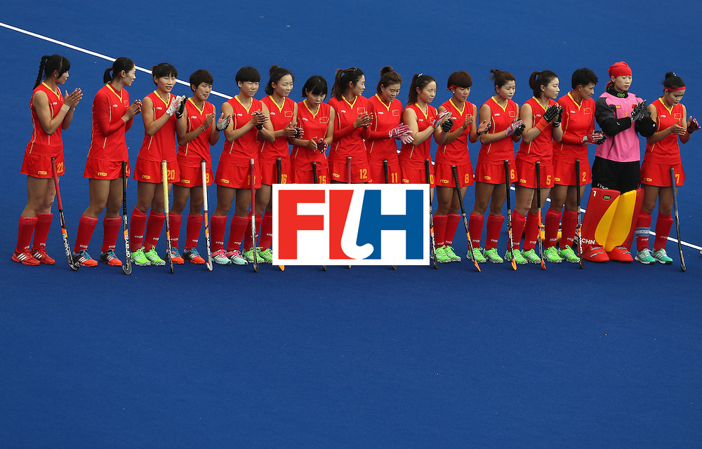RIO DE JANEIRO, BRAZIL - AUGUST 12:  Team China stands during introductions against Korea during a Women's Preliminary Pool A match on Day 7 of the Rio 2016 Olympic Games at the Olympic Hockey Centre on August 12, 2016 in Rio de Janeiro, Brazil.  (Photo by Sean Haffey/Getty Images)