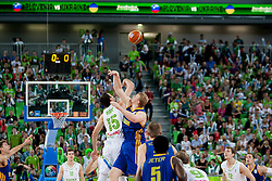 Mirza Begic of Slovenia and Kyryl Natyazhko #10 of Ukraine jumping for the first ball during basketball match between National teams of Slovenia and Ukraine in ranking of 5th to 8th place at Day 18 of Eurobasket 2013 on September 21, 2013 in SRC Stozice, Ljubljana, Slovenia. (Photo By Urban Urbanc / Sportida)