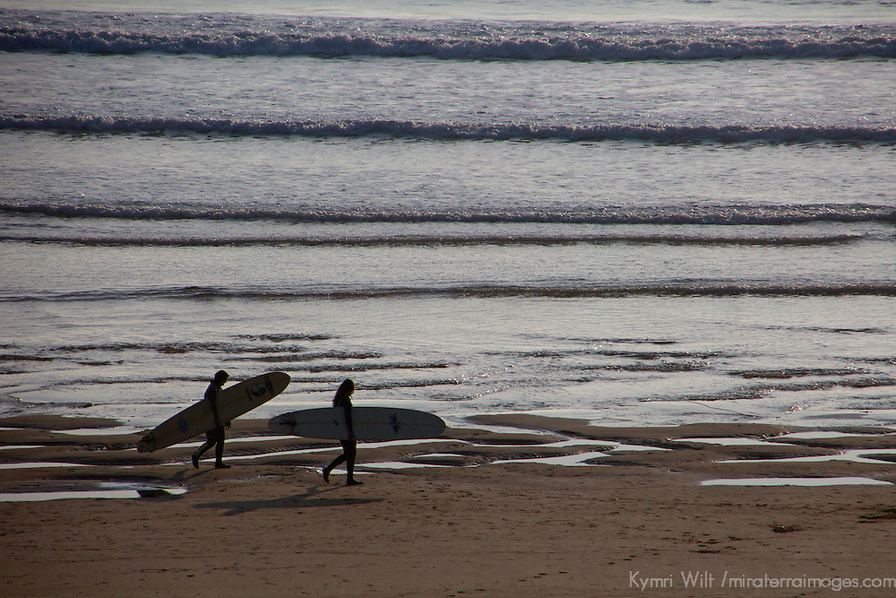 Europe, United Kingdom, Wales, Pembrokeshire. Surfers at Freshwater West Beach, Pembrokeshire, Wales.